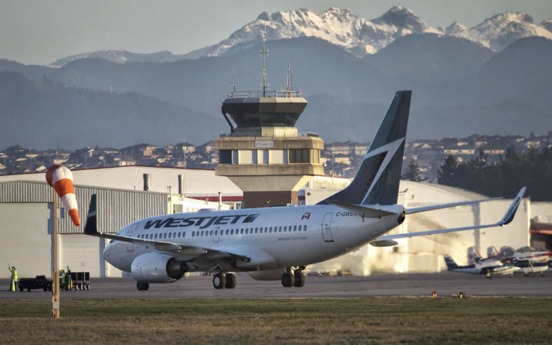 A WestJet airliner rests on the tarmac at Abbotsford International Airport. The company is enthused about a decision to eliminate Abbotsford's airport improvement fee. Mike Luedey Photo