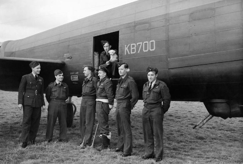 Squadron leader Reg Lane and the crew that ferried the Ruhr Express to England stand with the aircraft. Bomber Command Museum of Canada Photo