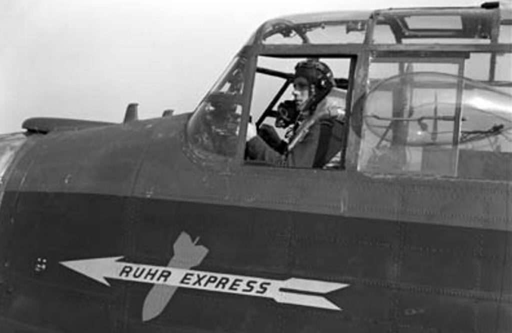 Pilot Officer Harold Floren sitting at the controls of the Ruhr Express around the time of her first operation in November 1943. Canadian Warplane Heritage Museum Photo