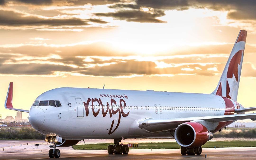 An Air Canada Rouge Boeing 767-300/ER crosses the sunset at Toronto Pearson International Airport. Photo submitted by Adam Tetzlaff