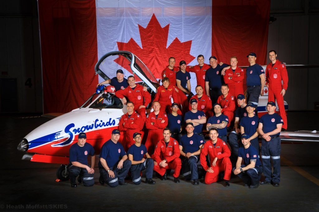 The Snowbirds pilots pose with their ground crew.