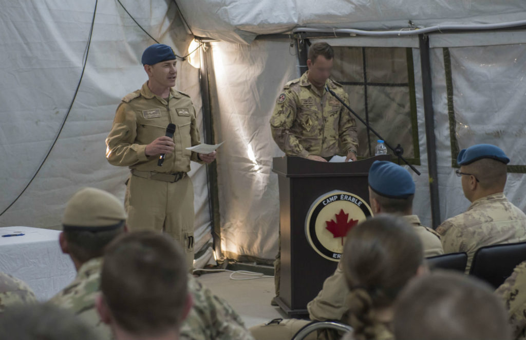 Incoming Tactical Aviation Detachment Commander, Maj James Shewchuk addresses the crowd during the transfer of authority ceremony held in Camp Érable, Iraq during Operation IMPACT. (Photo has been digitally altered for OPSEC purposes.) RCAF Photo