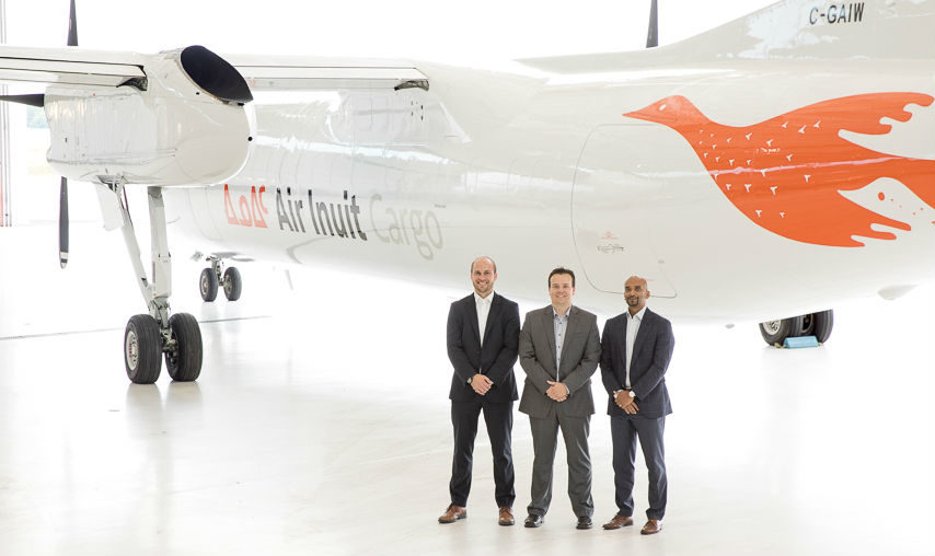 Unveiling the new freighter aircraft were (from left) David Vanderzwaag, Rockwell Collins; Christian Busch, Air Inuit; and Udaya Silva, Rockwell Collins.
