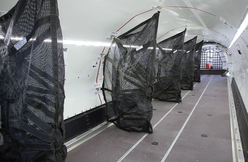 Vertical cargo nets separate the six individual zones down the length of the aircraft. Photos by A2P2.NET