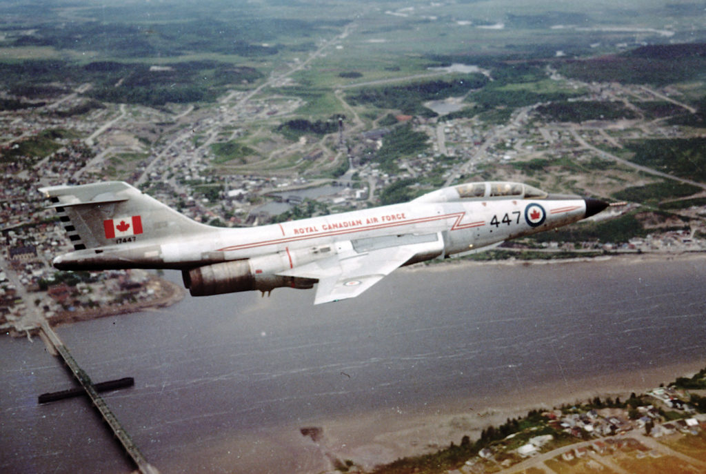 A 425 AW(F) Sqn CF-101B Voodoo flies over the St-Anne Bridge in Chicoutimi, 1967. F/O Turbo Tarling Photo