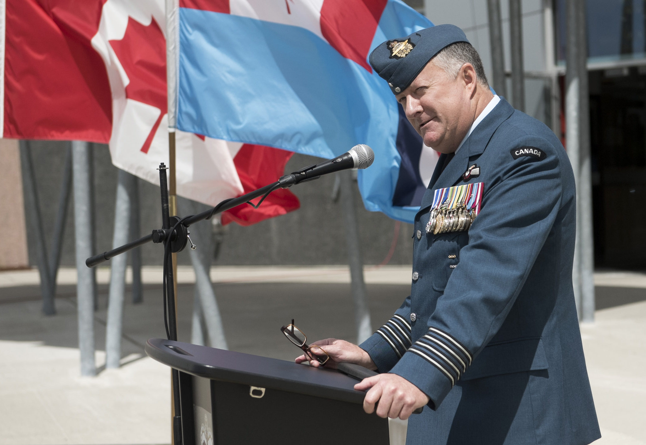 Col Shayne Elder, incoming commanding officer of the Canadian Aerospace Warfare Centre, speaks during the change of command ceremony held June 21, 2017, at Trenton, Ont.