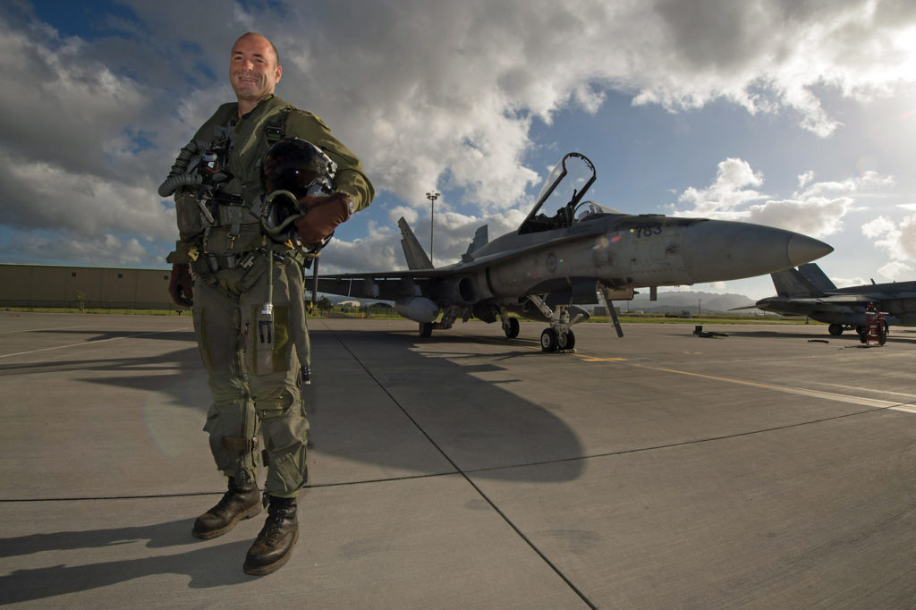 Col Darcy Molstad, commander of 3 Wing Bagotville, poses for a photo in front of a CF-188 Hornet before a training mission. MCpl Chris Ward Photo