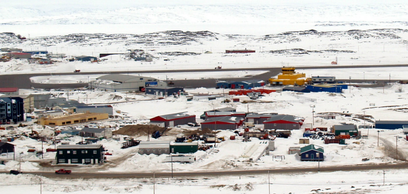 This photo of the Iqaluit airfield shows its original and 1987 terminals. The original airfield hangar was built in 1943 and still remains in use today. Kenneth Johnson Photo