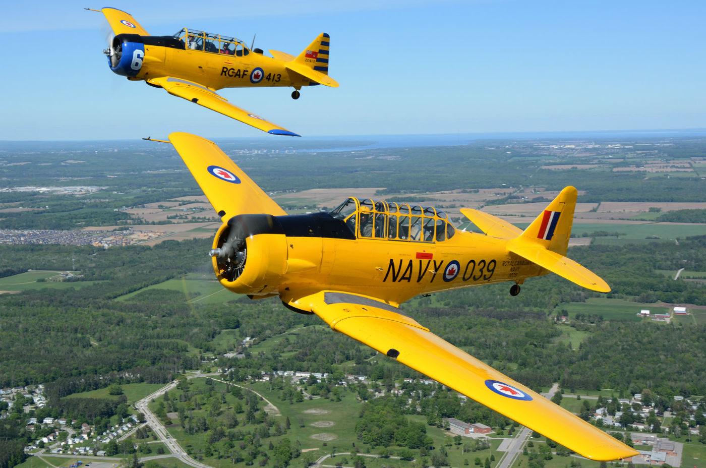 Glenn Goldman and Tom Siimes fly an MkII and Mk.4 Harvard over Base Borden.