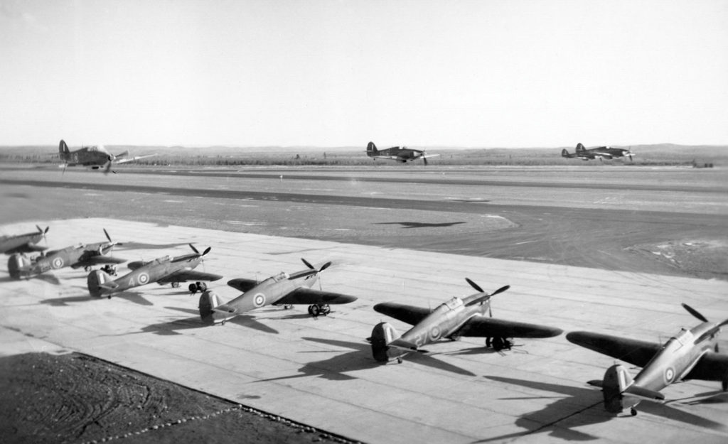 No. 1 OTU instructors perform a low pass in front of the unit's flight line, summer 1943. Bagotville Air Defence Museum Photo