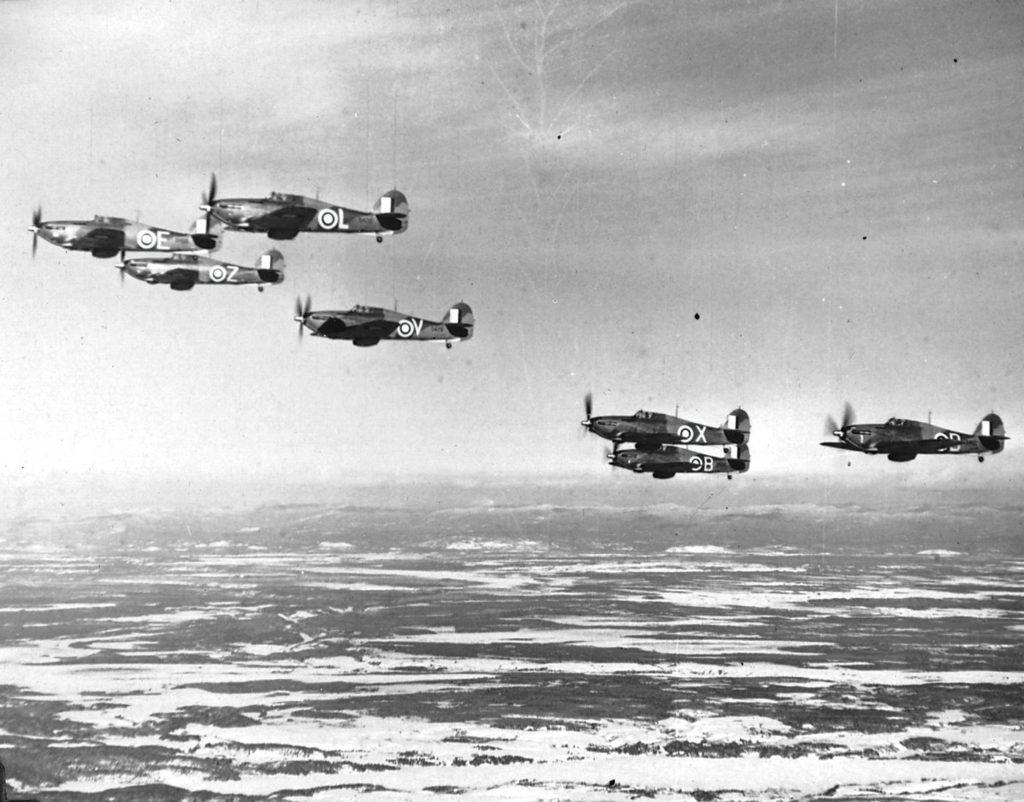 Seven Hawker Hurricanes flying over the Bagotville region, Jan. 29, 1943.