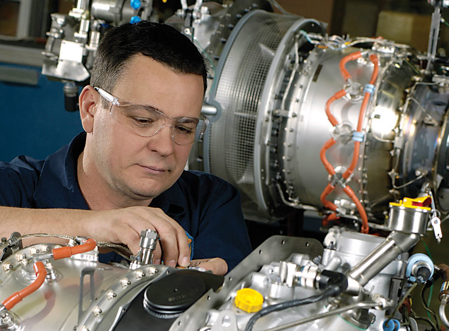 A P&WC engineer assembles a PW206C at the manufacturer's plant in Longueuil. P&WC Photo