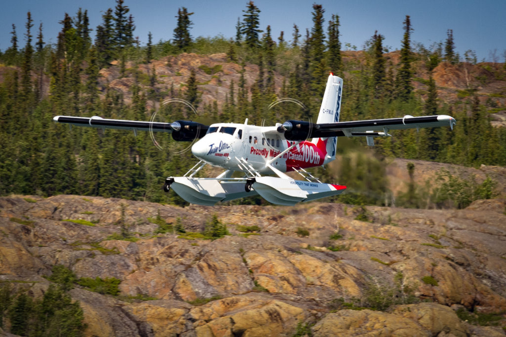 Series 400 Twin Otter in flight, with red and white Canadian livery