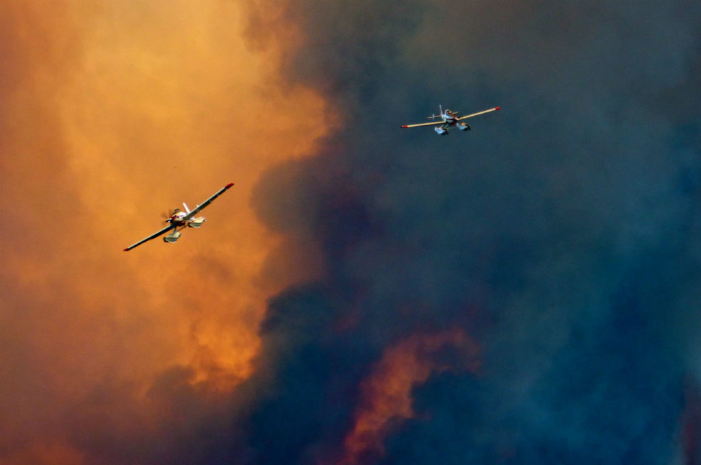 Two Air Tractor 802 amphibious Fire Boss air tankers fly over the 108 Mile House wildfire in B.C. Bob Grant Photo