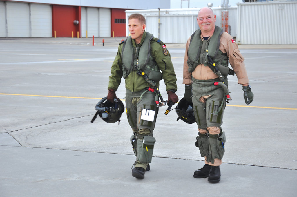 The author admits a flutter of nostalgic excitement walking to the CT-155 jet trainer with his instructor, Capt Ross Harbottle. DND Photo