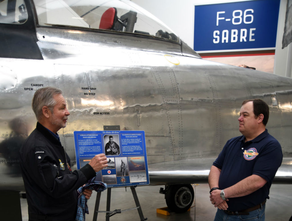 Don Mathews (left), Air Force Museum Society of Alberta board chair, unveils the plaque with Kevin Anderson, executive director of the New Brunswick museum of aviation.