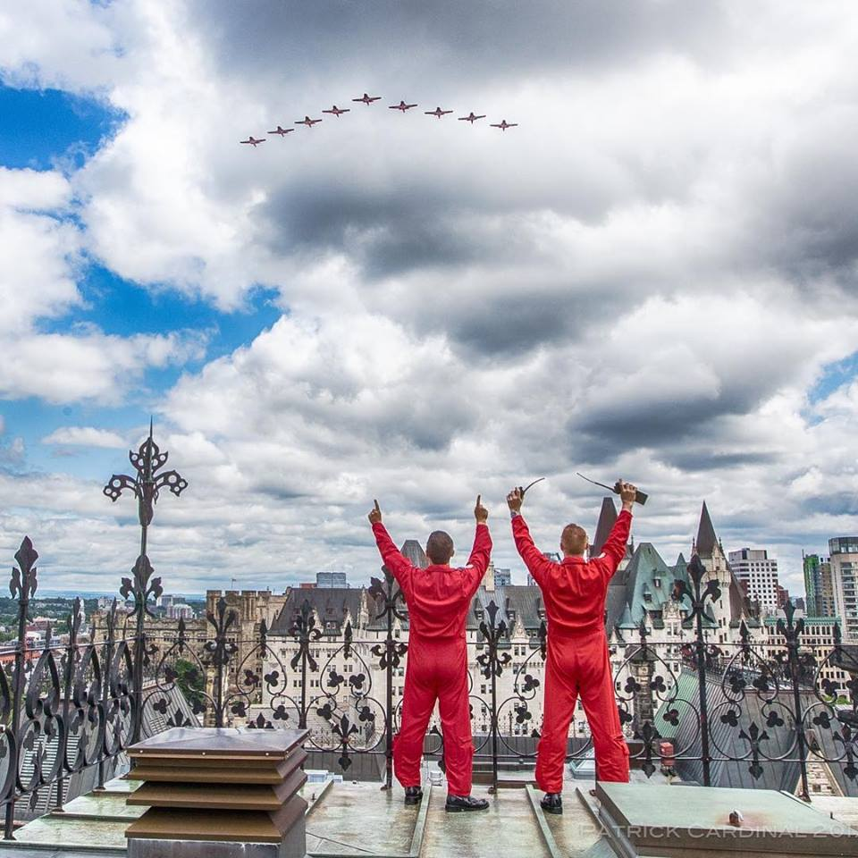 Canadian Forces Snowbirds coordinators cheer on the formation during the flypast on Parliament Hill in celebration of Canada's 150th anniversary. Photo submitted by Patrick Cardinal