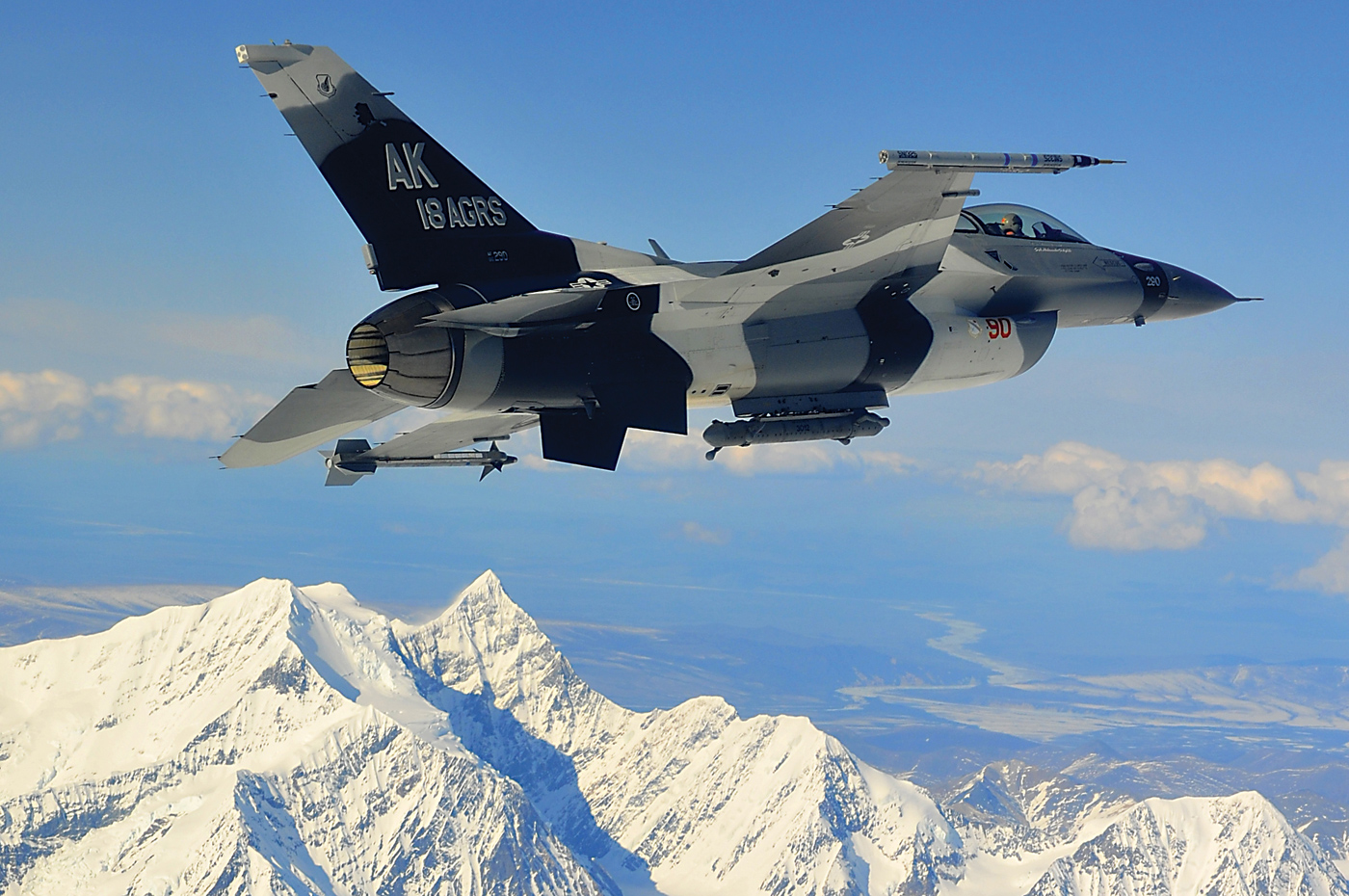 An F-16 from the 18th Aggressor Squadron soars over the Joint Pacific Alaska Range Complex. The squadron is responsible for training and preparing joint and allied aircrews for combat missions. Staff Sgt Christopher Boitz Photo