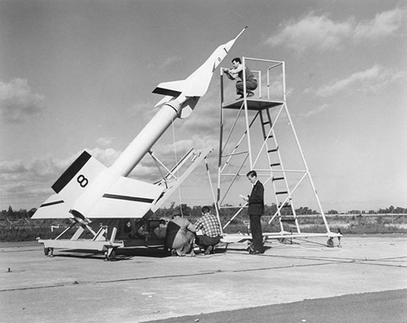 Avro technicians prepare an Avro Arrow test model attached to a Nike booster rocket to fire out over Lake Ontario at Point Petre in the 1950s. Kraken Sonar Inc. Photo