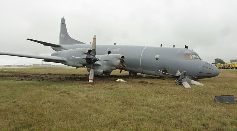 The aircraft plowed through the soft earth and the nose gear collapsed, causing the inside propeller on the right side of the aircraft to strike the ground and break away from the engine. RCAF Photo