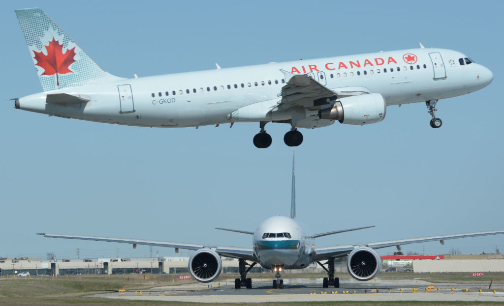 The TSB report indicates the Airbus had overflown the taxiway for about 0.25 miles before the crew was instructed to go around. The document estimates that the Air Canada jet cleared the first two aircraft on the taxiway by just 100 feet; the third by 200 feet; and the fourth by 300 feet. Eric Dumigan Photo