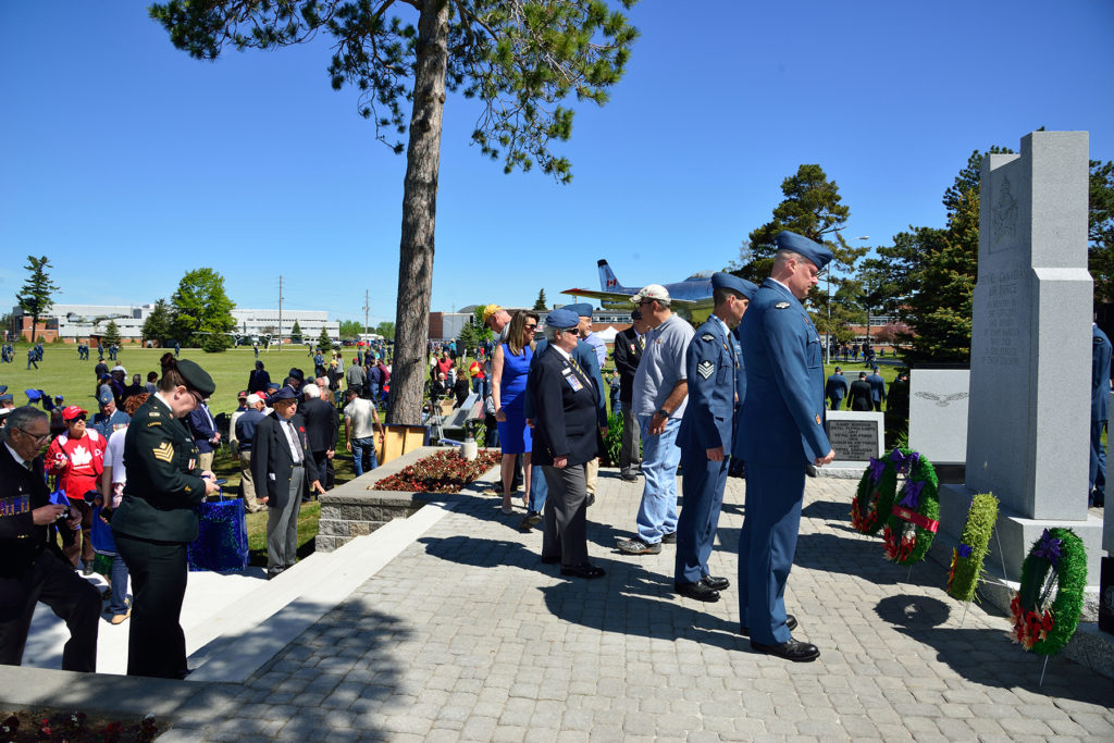 Military personnel, family members, and guests gather to get a closer view of the newly rebuilt Royal Canadian Air Force Memorial after the unveiling parade on June 3, 2017, at 16 Wing/Canadian Forces Base Borden, Ont