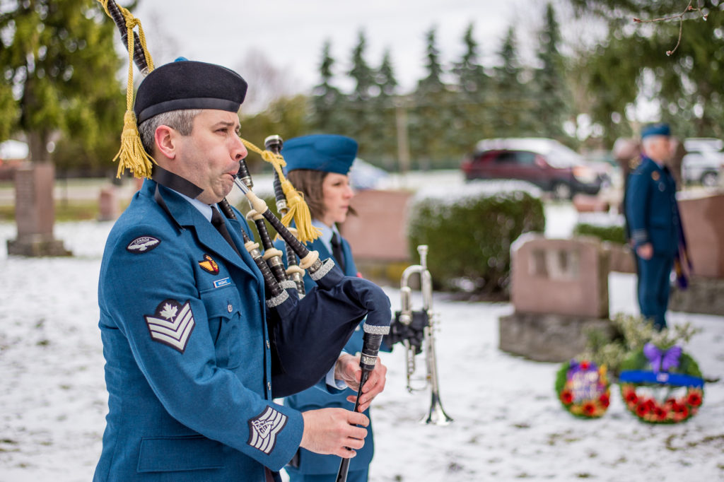 Sgt Matthew MacIsaac plays Lament on the bag pipes during the remembrance ceremony commemorating the 100th anniversary of the first casualty of military flying in Canada, at Dorchester Union Cemetery, in Dorchester Ont., on April 7, 2017.