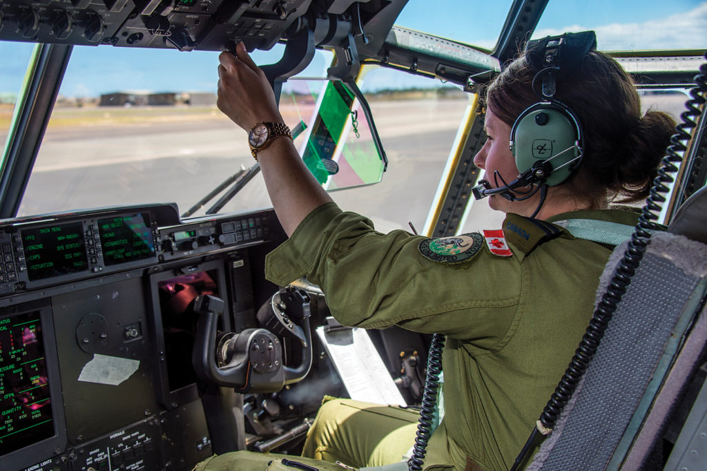 Capt Skye Simpson, a pilot from 436 Transport Squadron, 8 Wing Trenton, prepares to fly the CC-130J Hercules during RIMPAC 16 in Hawaii. MCpl Mathieu Gaudreault Photo