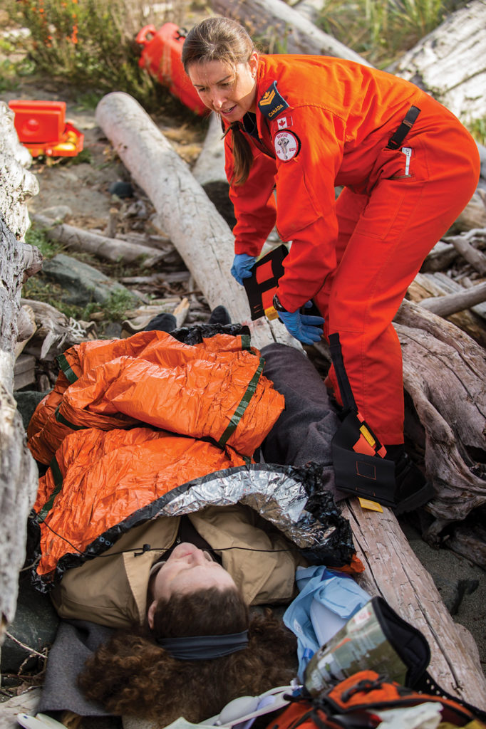 Search and rescue technician MCpl Ashley Barker, with 413 Squadron from 14 Wing Greenwood, attends to the injuries of a casualty during a medical event at SAREX 15 in Comox, B.C. Cpl Ian Thompson Photo