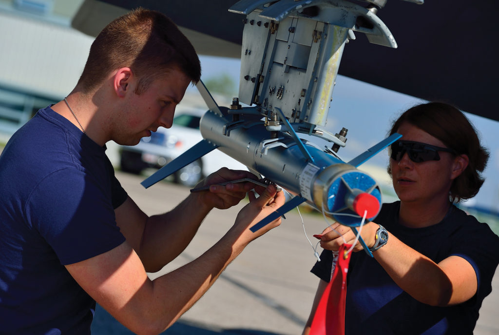 Cpl Cindy Bergeron, a weapons technician with 425 Tactical Fighter Squadron, installs a laser-guided training round on a CF-188 Hornet. MCpl Marc-Andre Gaudreault Photo