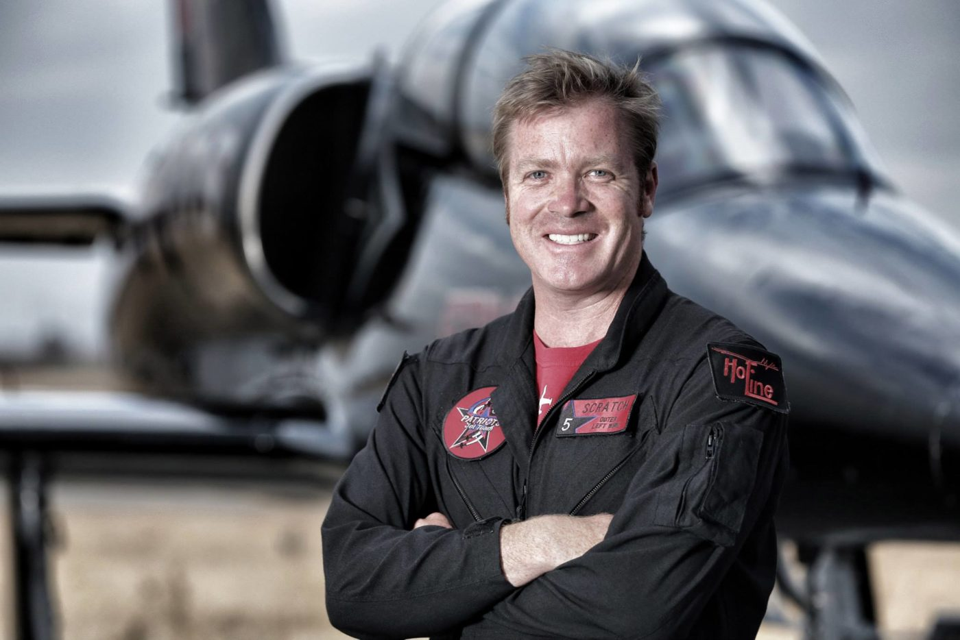 Scratch stands on the set of Airshow, the Discovery Canada series in which he acted both as a consulting producer and as a pilot on the Patriots Jet Team.