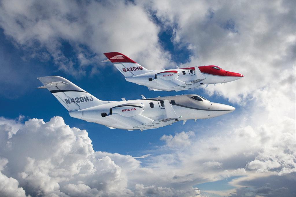 Two HondaJets in flight.