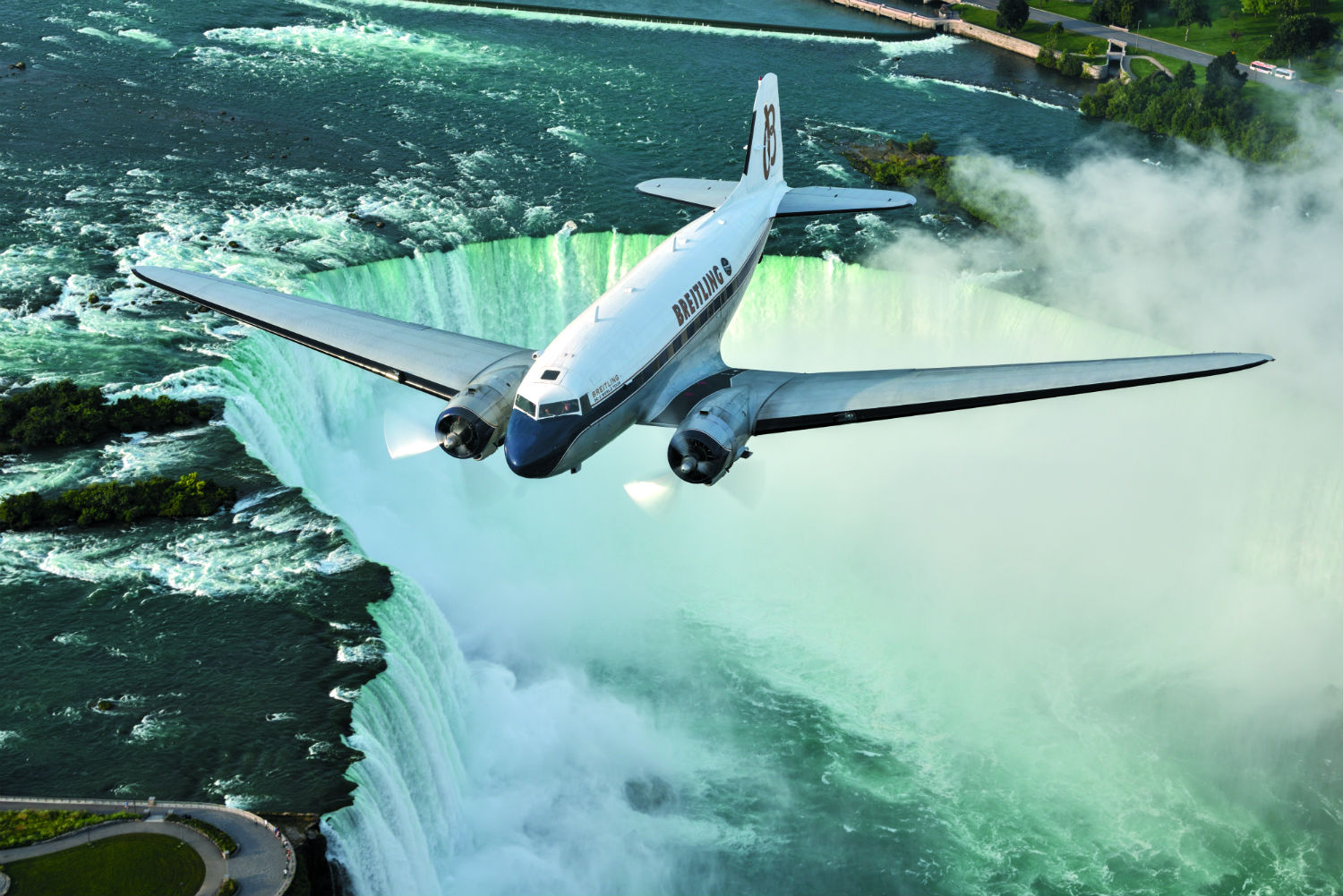 DC-3 flies over waterfall