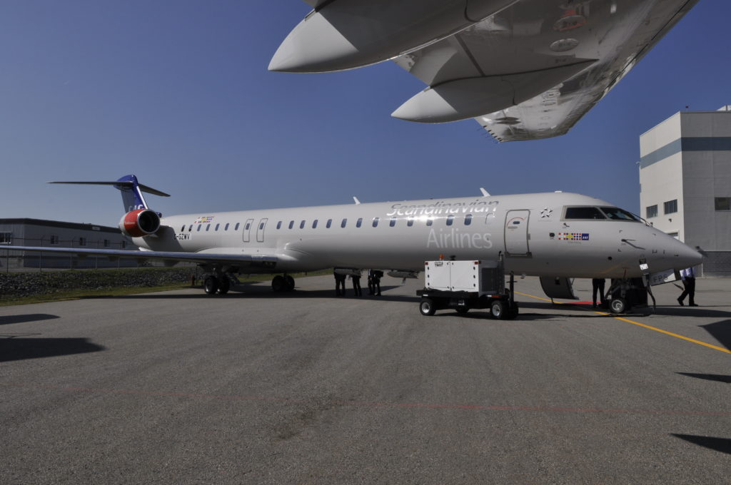CRJ aircraft rests on tarmac