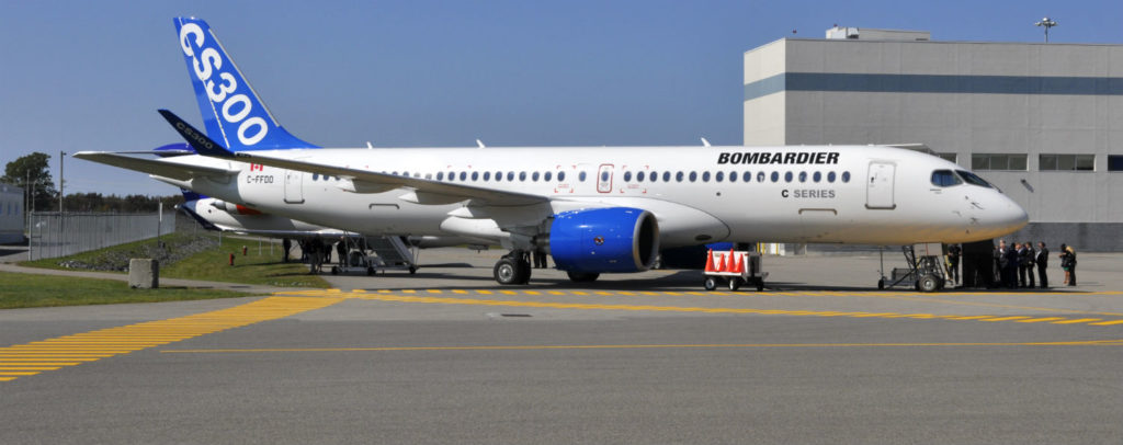 A Bombardier CS300 rests on the tarmac