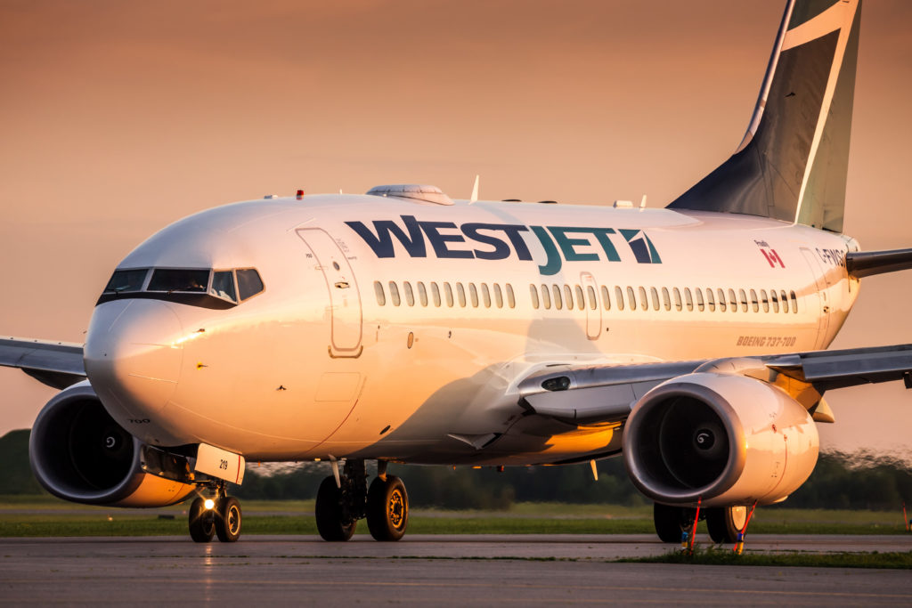 WestJet airliner resting on tarmac
