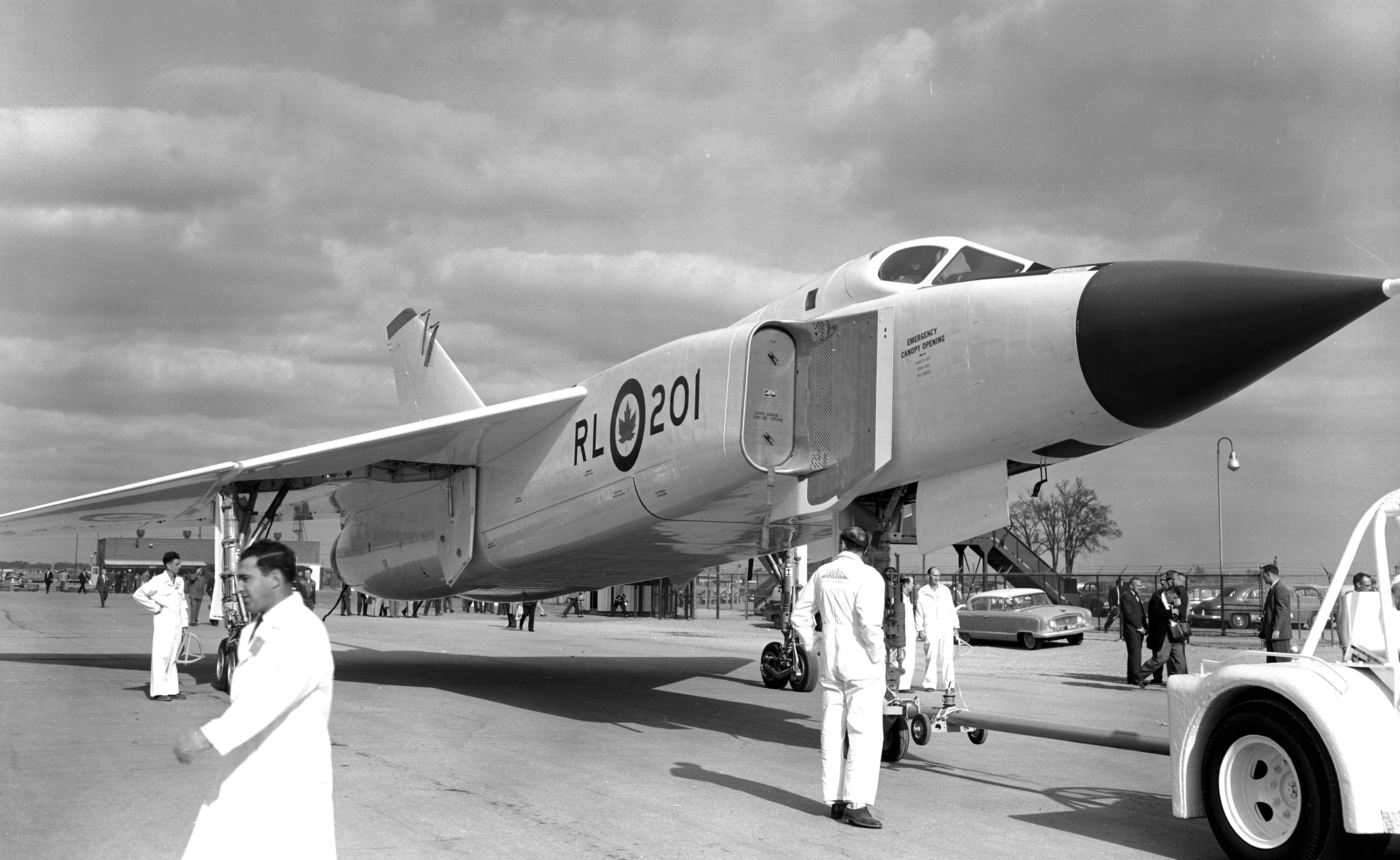 Front right view of an Avro Arrow sitting on the tarmac of de Havilland's hangar in Dowsview (Toronto), Ont., in 1957