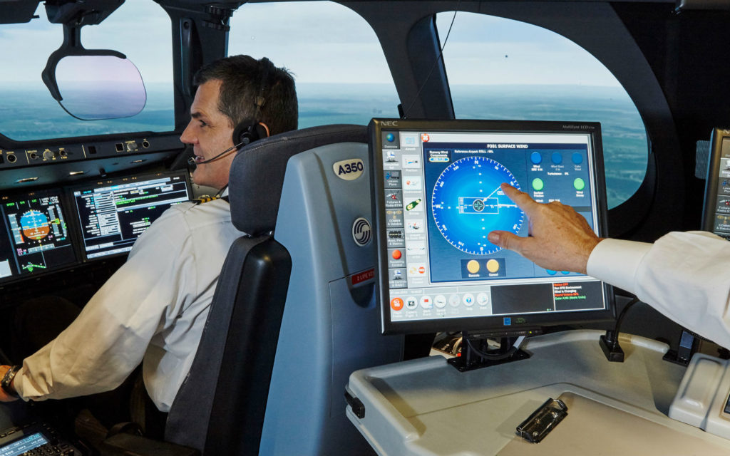 Man sits in simulator