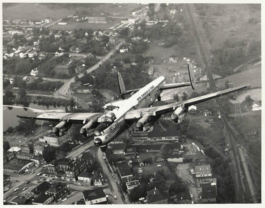 Lancaster KB882 flies over Edmundston, New Brunswick, on its final flight on July 14, 1964.