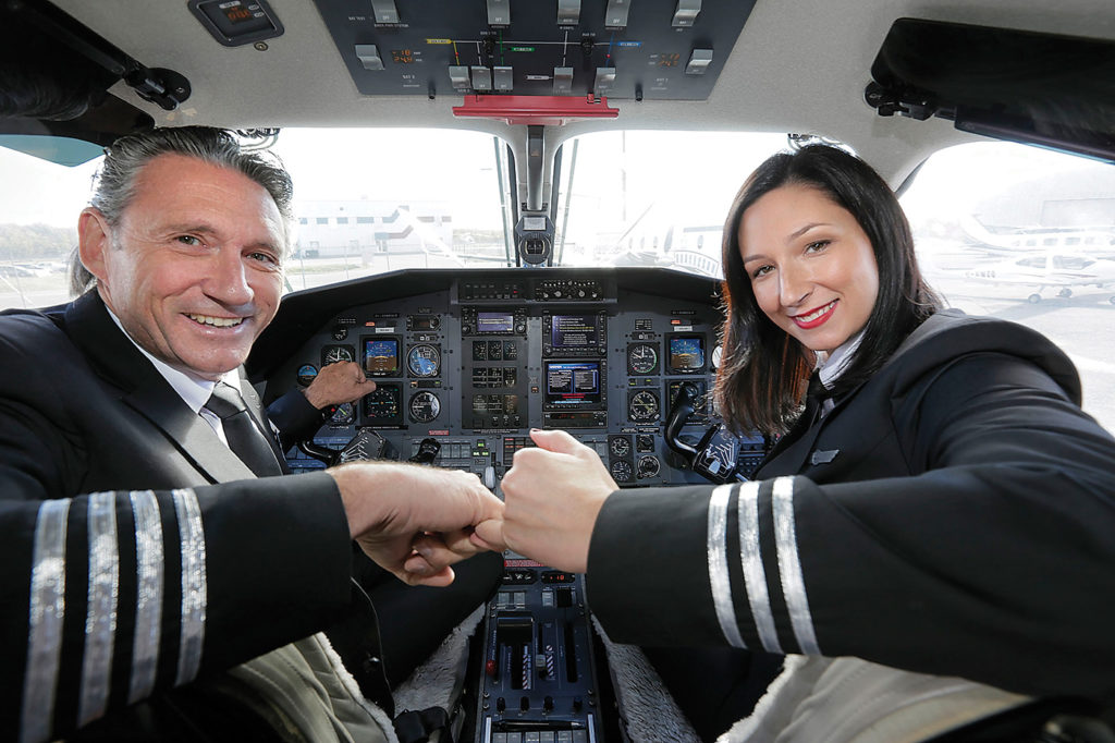 Patrick Carpin (retired from Air Canada) with his daughter Nancy Carpin, both pilots at Chrono. The father-daughter duo realized a dream of flying together on the PC-12.
