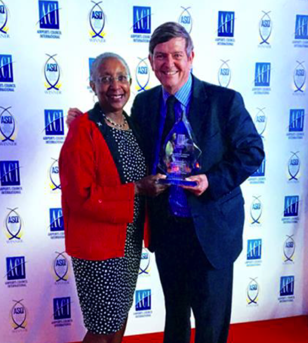 Tom Ruth, president and chief executive officer of EIA receives the third place 'Best Airport by Region' award for North America from Angela Gittens, head of Airports Council International. EIA Photo