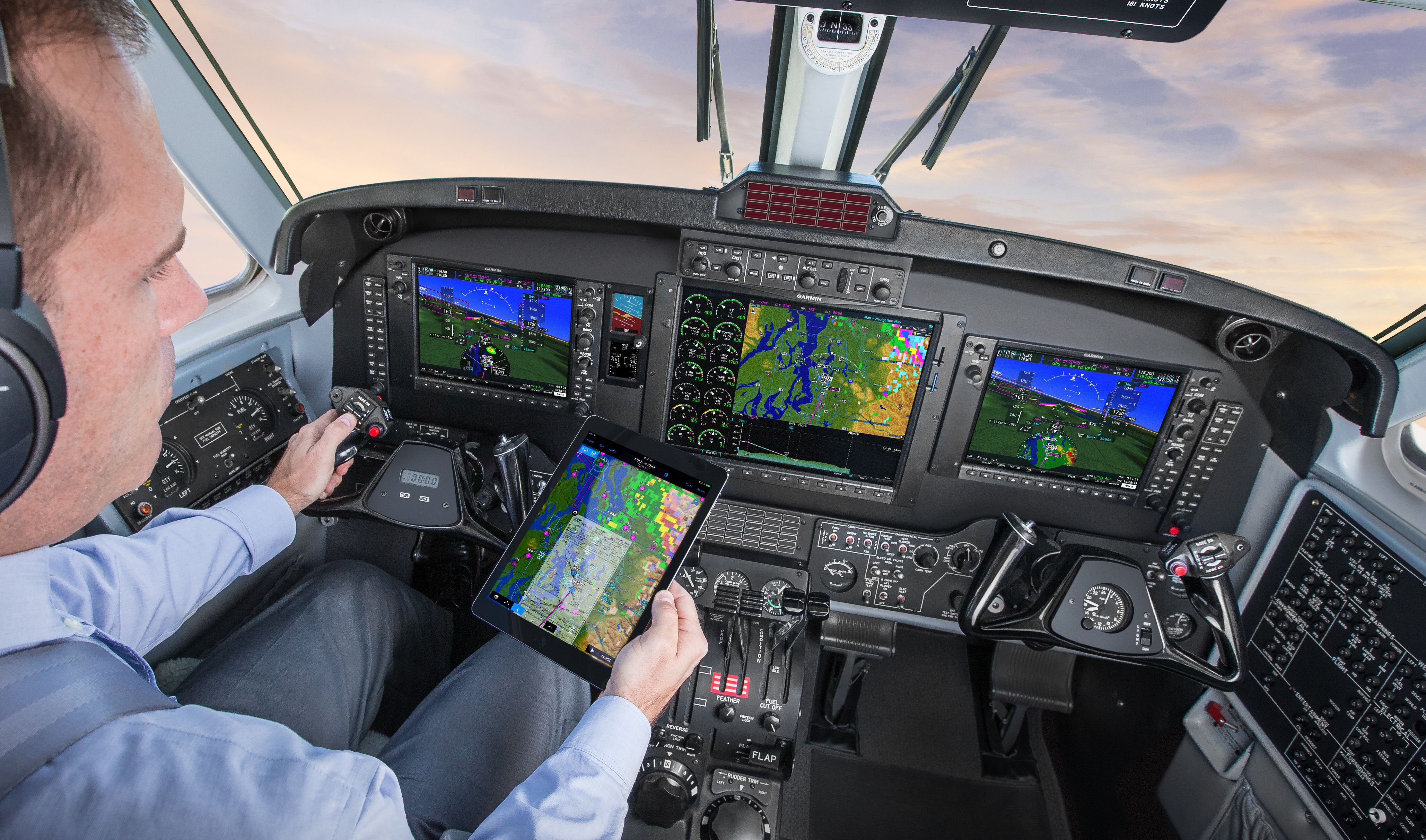 Man sits in cockpit of aircraft