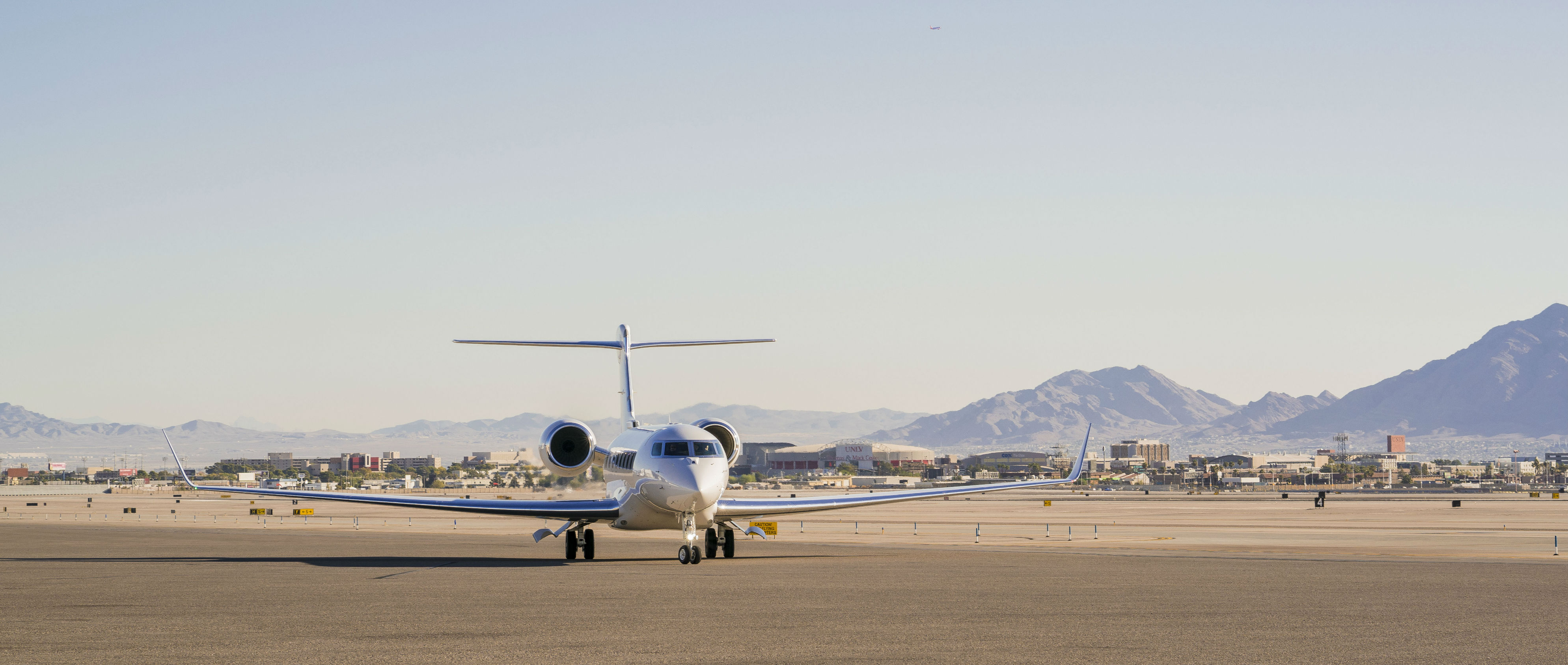 Gulfstream G650ER rests on runway.