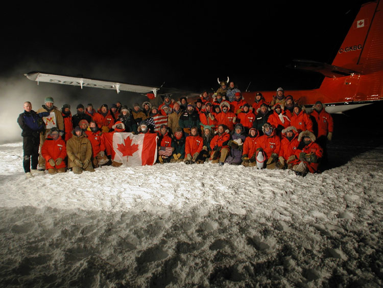 A group poses at the South Pole Station after Loutitt's 2001 rescue flight.