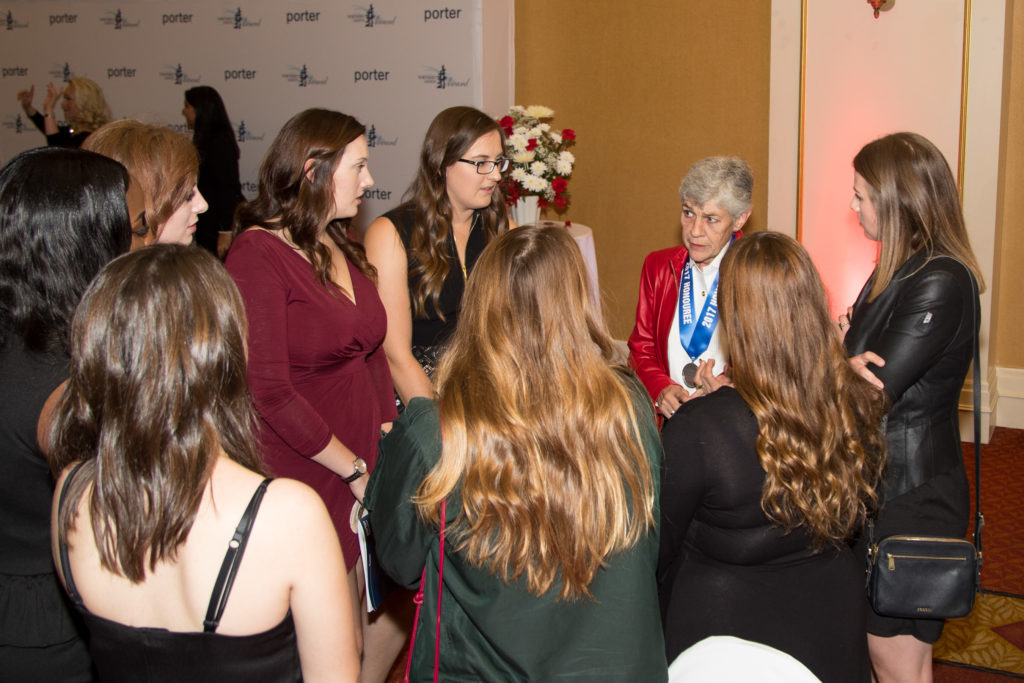 Maj Deanna Brasseur passes on her wisdom to a group of young women at the gala.