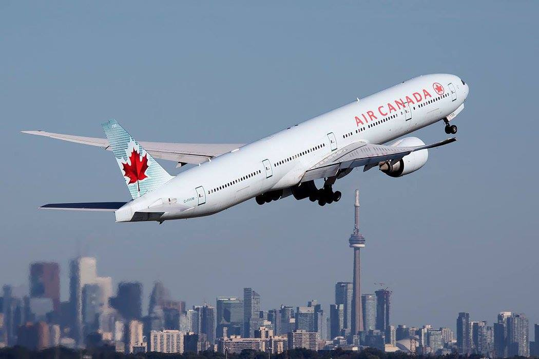 Air Canada take off, with the iconic Toronto skyline as a backdrop. Photo submitted by David Brook‎