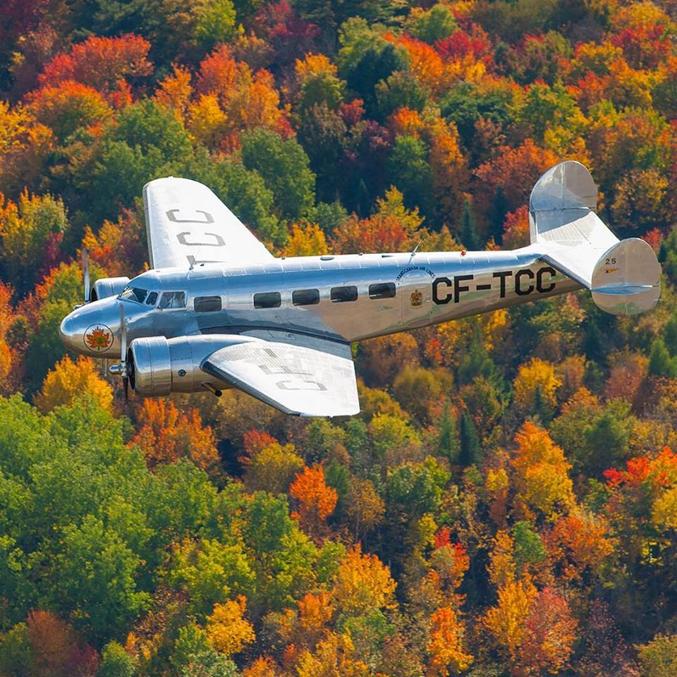Air Canada's Lockheed 10A vintage aircraft soars over a colourful forest in northeast Quebec. Photo submitted by Brian Losito (Instagram user @brianlosito) using #skiesmag