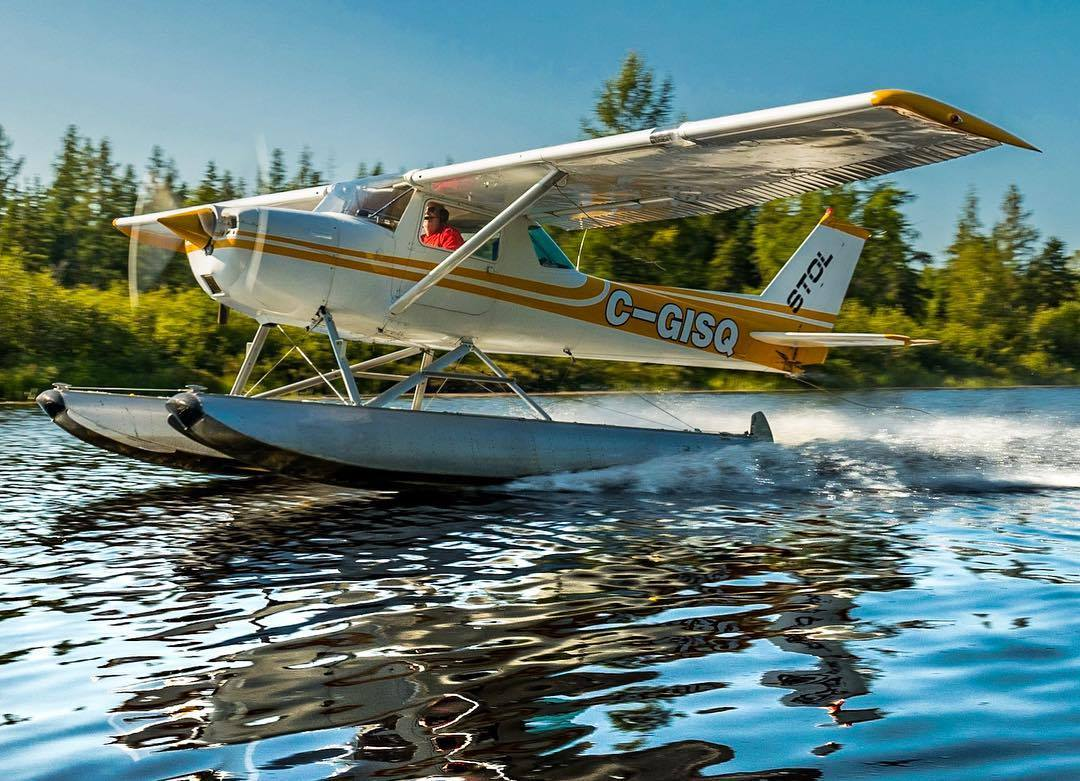 A Cessna 150 glides across the Ruban River in Quebec. Photo submitted by Daniel Villeneuve (Instagram user @daniel_vi11eneuve) using #skiesmag