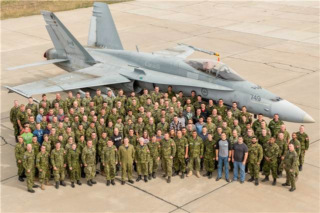 Group photo of Air Task Force Romania personnel, currently deployed on Operation Reassurance in support of NATO enhanced Air Policing, in front of CF-188 Hornet aircraft, at Mihail Kogalniceanu Air Base, Constanta, Romania, on Oct. 5, 2017. Sgt Daren Kraus Photo
