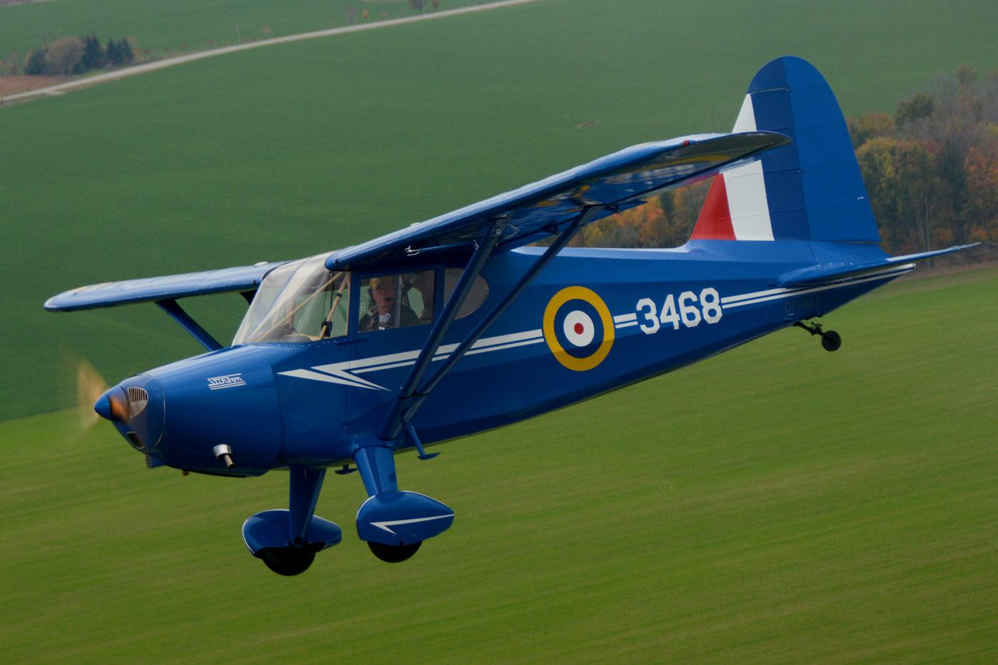 Murray Kot flying his 1939 ex-RCAF Stinson HW-75 (105) Voyager. Eric Dumigan Photo